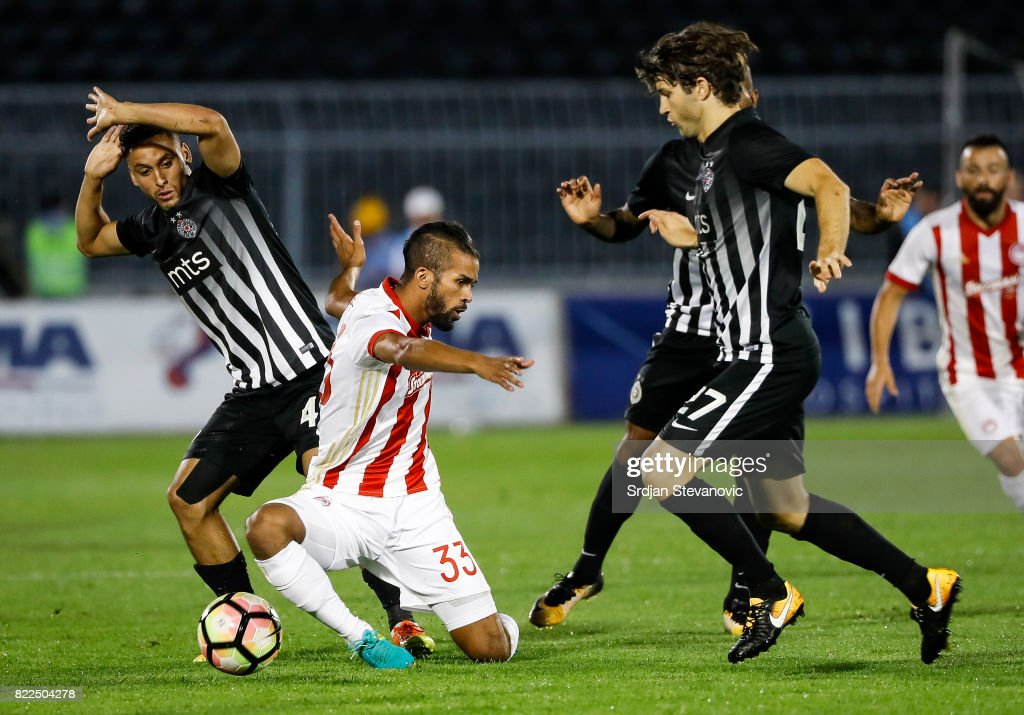 Mahdi Carcela-Gonzales (C) of Olympiacos in action against Leonardo (L) and Nebojsa Kosovic (R) of Partizan during the UEFA Champions League Qualifying match between FC Partizan and Olympiacos on July 25, 2017 in Belgrade, Serbia.