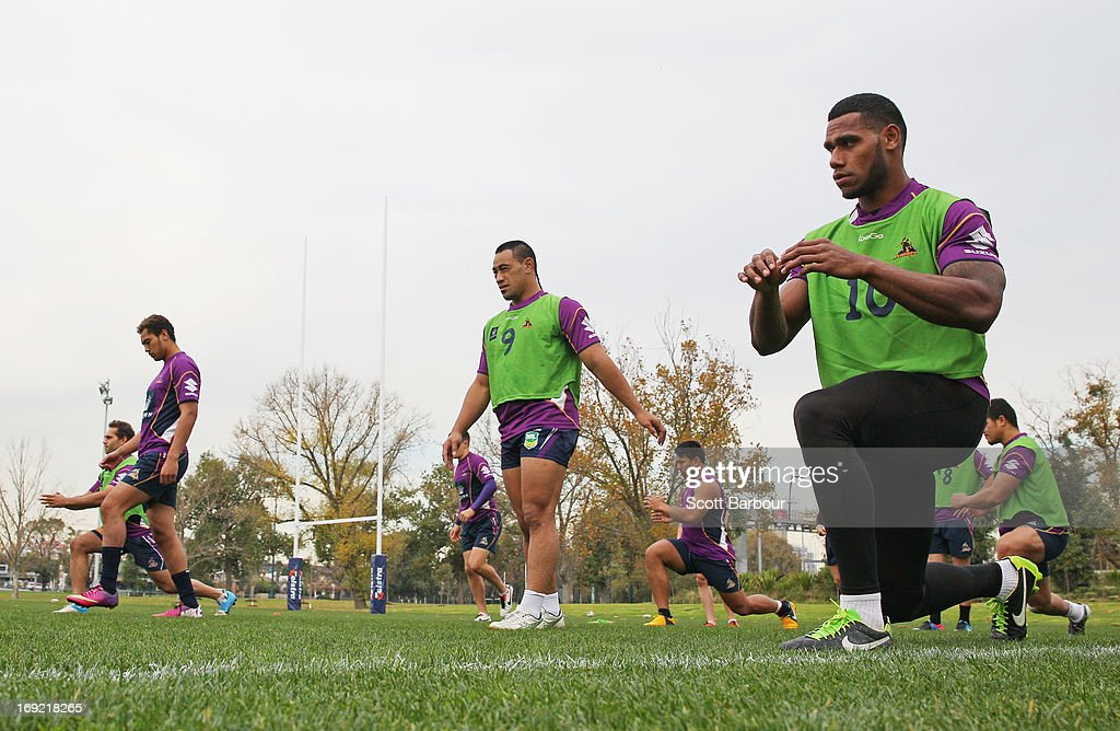 Mahe Fonua (C) and Sisa Waqa (R) of the Storm stretch during a Melbourne Storm NRL training session at Gosch's Paddock on May 22, 2013 in Melbourne, Australia.