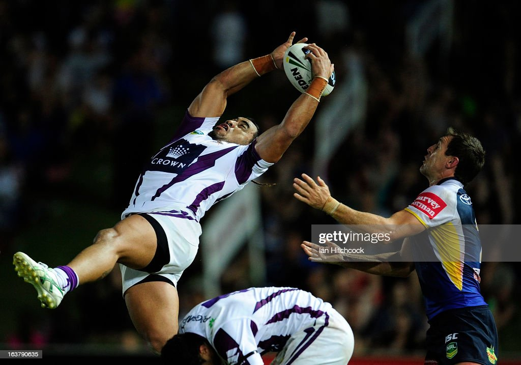 Mahe Fonua of the Storm catches a high ball over Ashley Graham of the Cowboys during the round two NRL match between the North Queensland Cowboys and the Melbourne Storm at 1300SMILES Stadium on March 16, 2013 in Townsville, Australia.
