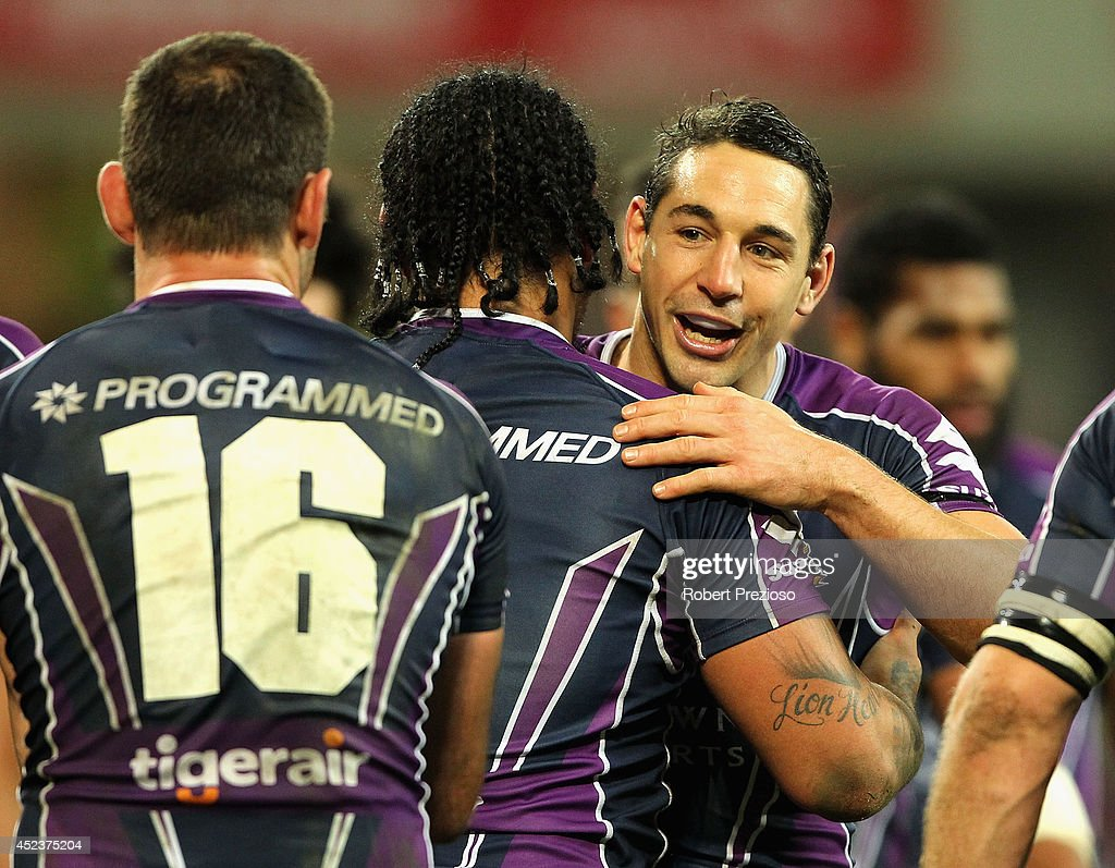 Mahe Fonua of the Storm celebrates with team-mate Billy Slater after crossing the line to score a try during the round 19 NRL match between the Melbourne Storm and the Canberra Raiders at AAMI Park on July 19, 2014 in Melbourne, Australia.