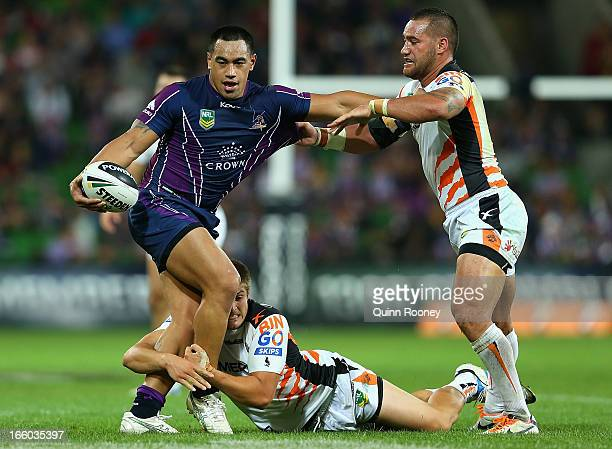 Mahe Fonua of the Storm is tackled by Blake Ayshford of the Tigers during the round 5 NRL match between the Melbourne Storm and the Wests Tigers at...
