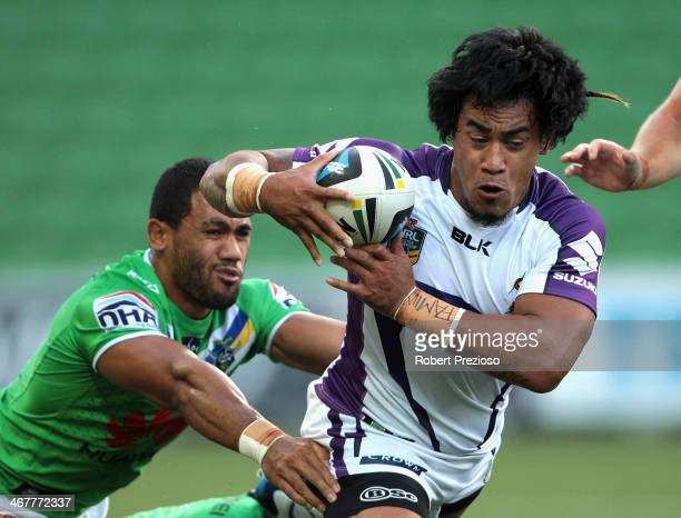 Mahe Fonua of the Storm is tackled during the NRL trial match between the Melbourne Storm and the Canberra Raiders at AAMI Park on February 8, 2014...