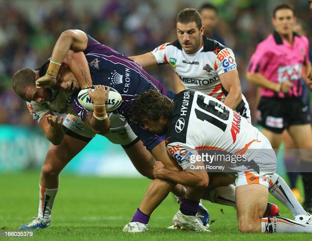 Mahe Fonua of the Storm is tackled during the round 5 NRL match between the Melbourne Storm and the Wests Tigers at AAMI Stadium on April 8, 2013 in...