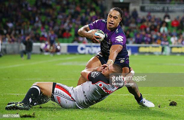 Mahe Fonua of the Storm pushes away Tuimoala Lolohea of the Warriors during the round five NRL match between the Melbourne Storm and the New Zealand...
