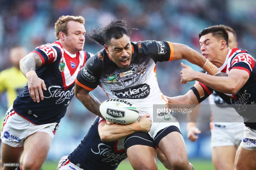 Mahe Fonua of the Tigers is tackled during the round 13 NRL match between the Sydney Roosters and the Wests Tigers at Allianz Stadium on June 3, 2018 in Sydney, Australia.
