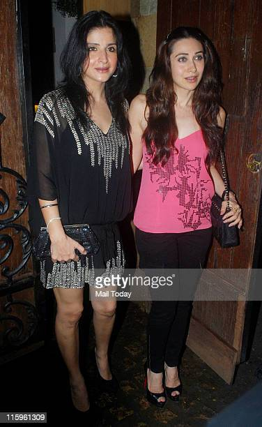 Maheep Kapoor with Karisma Kapur arrives to attend the birthday bash of Sonam Kapoor at her residence in Mumbai on June 9 2011