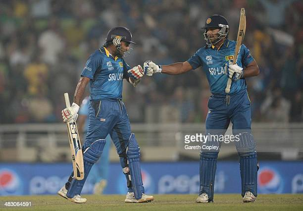 Mahela Jayawardena and Kumar Sangakkara of Sri Lanka touch gloves during the ICC World Twenty20 Bangladesh 2014 Final between India and Sri Lanka at...