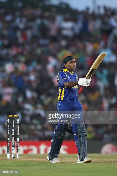 Mahela Jayawardena of Sri Lanka acknowledges the crowd after completing his century during the Sri Lanka v Canada 2011 ICC World Cup Group A match at...