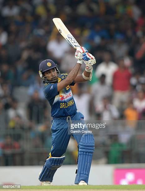 Mahela Jayawardena of Sri Lanka hits out for six runs during the 2nd One Day International match between Sri Lanka and England at R Premadasa Stadium...