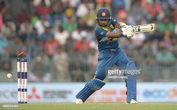 Mahela Jayawardena of Sri Lanka is bowled by Chris Jordan of England during the 4th One Day International match between Sri Lanka and England at R...