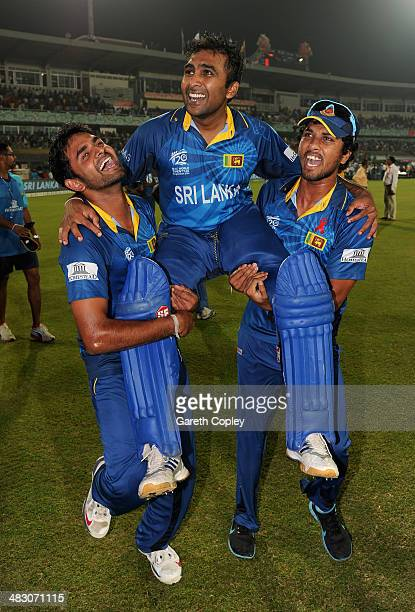 Mahela Jayawardena of Sri Lanka is chaired from the field by Lahiru Thirimanne and Dinesh Chandimal after winning the ICC World Twenty20 Bangladesh...