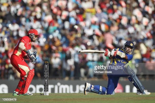 Mahela Jayawardena of Sri Lanka reverse sweeps as Canada wicketkeeper Ashish Bagai looks on during the Sri Lanka v Canada 2011 ICC World Cup Group A...