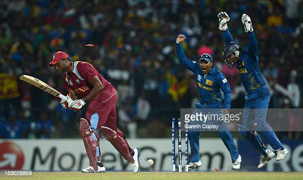 Mahela Jayawardene and Kumar Sangakkara of Sri Lanka celebrate after Kieron Pollard of the West Indies is bowled by Ajantha Mendis during the ICC...