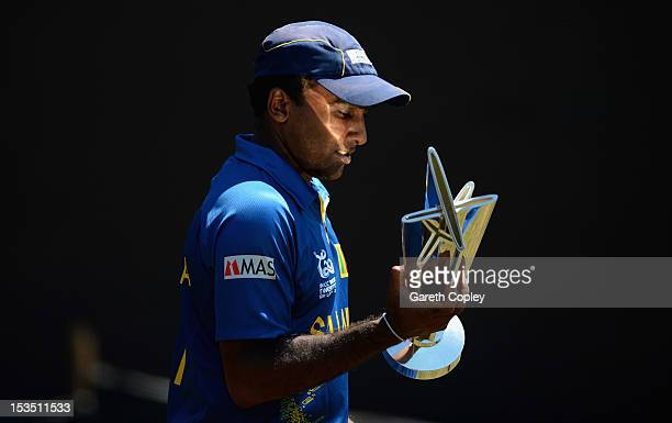 Mahela Jayawardene holds the ICC World T20 trophy during a photocall ahead of the 2012 ICC World Twenty20 Final at R. Premadasa Stadium on October 6,...