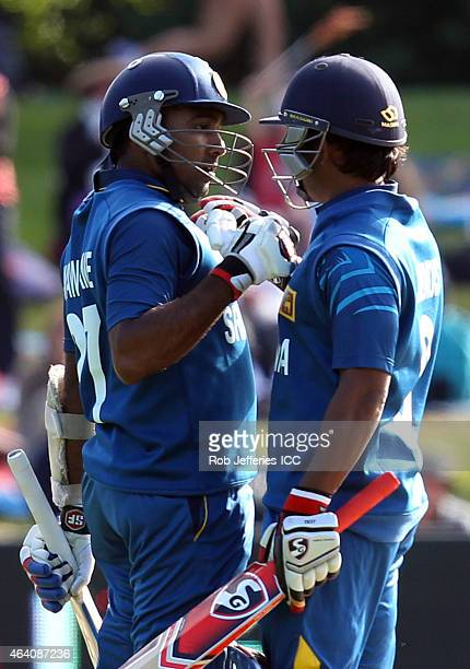 Mahela Jayawardene of Sri Lanka celebrates his 100 runs with Jeevan Mendis during the 2015 ICC Cricket World Cup match between Sri Lanka and...