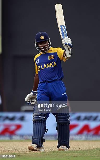 Mahela Jayawardene of Sri Lanka celebrates his century during the ICC T20 World Cup Group B match between Sri Lanka and Zimbabwe at the Guyana...