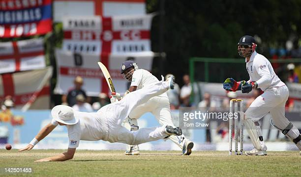 Mahela Jayawardene of Sri Lanka hits the ball past a diving Ian Bell of England during day 4 of the 2nd test match between Sri Lanka and England at...