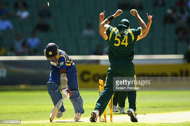 Mahela Jayawardene of Sri Lanka is run out by a direct hit from David Hussey of Australia during the One Day International match between Australia...