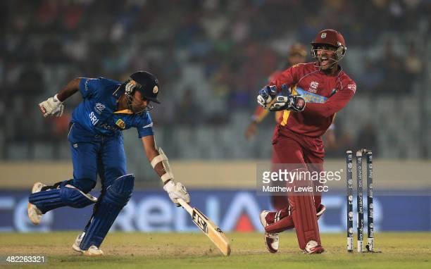 Mahela Jayawardene of Sri Lanka is run out by Darren Sammy of the West Indies, as Denesh Ramdin celebrates during the ICC World Twenty20 Bangladesh...