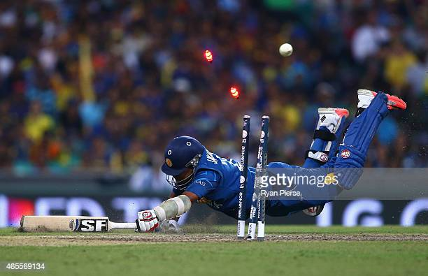 Mahela Jayawardene of Sri Lanka is run out by Michael Clarke of Australia during the 2015 ICC Cricket World Cup match between Australia and Sri Lanka...