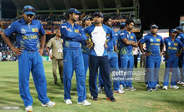 Mahela Jayawardene of Sri Lanka looks on with his team after they lost to the West Indies in the ICC World Twenty20 2012 Final between Sri Lanka and...