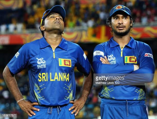 Mahela Jayawardene of Sri Lanka looks on with Kumar Sangakkara, after his team lost the ICC World Twenty20 2012 Final between Sri Lanka and West...