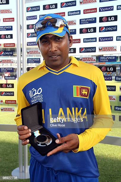Mahela Jayawardene of Sri Lanka poses with his man of the match award after the ICC World Twenty20 Super Eight match between West Indies and Sri...