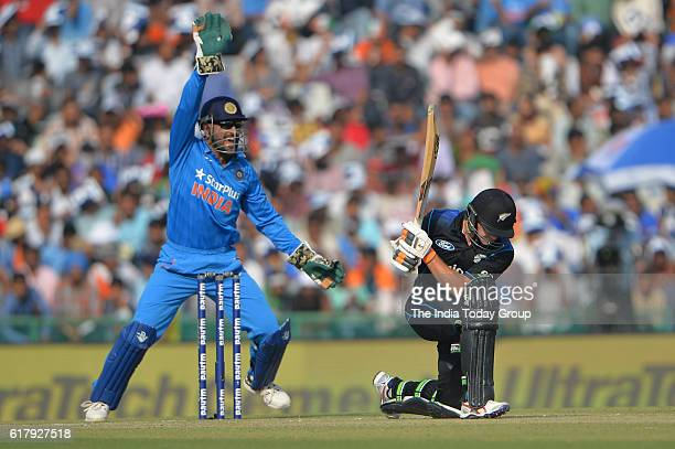 Mahendra Singh Dhoni captain of India appeals unsuccessfully for the wicket of Tom Latham of New Zealand during the third oneday international...