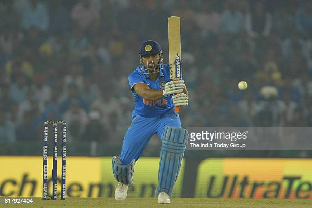 Mahendra Singh Dhoni captain of India bats during the third oneday international cricket match against New Zealand in Mohali