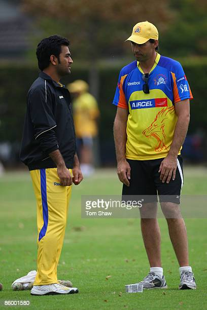 Mahendra Singh Dhoni of Chennai chats to coach Stephen Fleming during the Chennai Super Kings training session at the Vineyard Cricket Ground on...