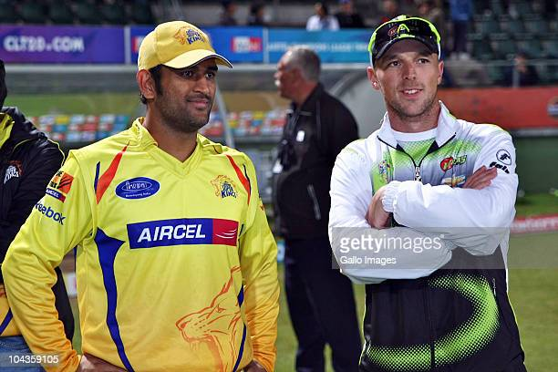 Mahendra Singh Dhoni of Chennai Super Kings and David Jacobs during the Airtel Champions League Twenty20 match between Chevrolet Warriors and Chennai...