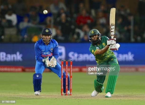 Mahendra Singh Dhoni of India and Hashim Amla of South Africa during the 5th Momentum ODI match between South Africa and India at St Georges Park on...