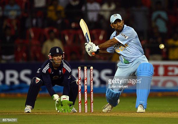 Mahendra Singh Dhoni of India attacks the bowling of Graeme Swann during the 4th One Day International between India and England played at The...