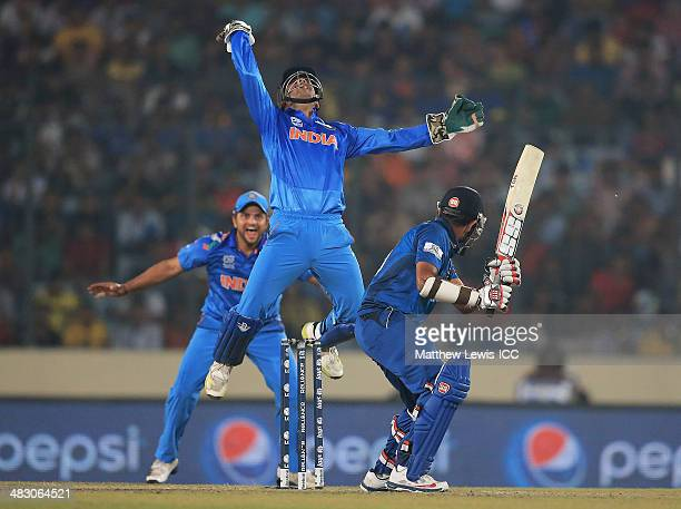 Mahendra Singh Dhoni of India celebrates catching Lahiru Thirimanne of Sri Lanka off the bowling of Amit Mishra during the ICC World Twenty20...