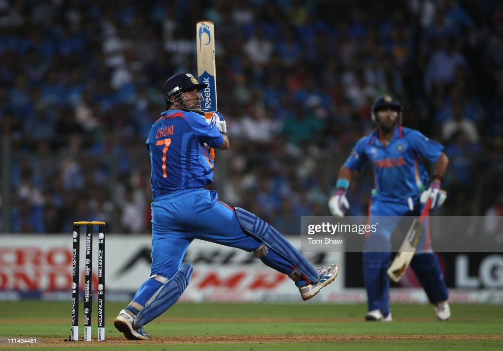Mahendra Singh Dhoni of India hits a six during the 2011 ICC World Cup Final between India and Sri Lanka at the Wankhede Stadium on April 2, 2011 in Mumbai, India.