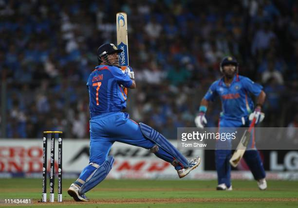 Mahendra Singh Dhoni of India hits a six during the 2011 ICC World Cup Final between India and Sri Lanka at the Wankhede Stadium on April 2 2011 in...