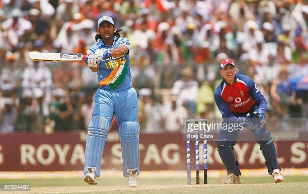 Mahendra Singh Dhoni of India hits out during the Sixth One Day International between India and England at the Keenan Stadium on April 12 2006 in...