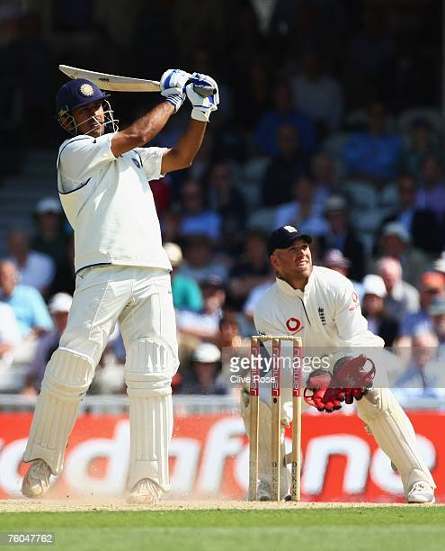 Mahendra Singh Dhoni of India hits out watched by Matt Prior of England during day two of the Third Test match between England and India at the Oval...