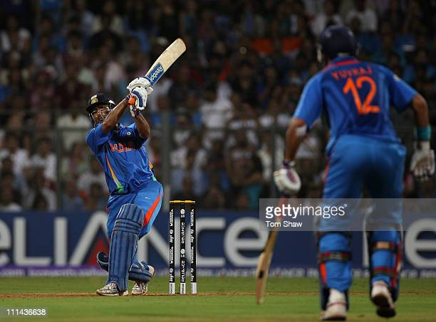 Mahendra Singh Dhoni of India hits the winning runs during the 2011 ICC World Cup Final between India and Sri Lanka at the Wankhede Stadium on April...