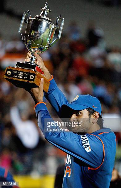 Mahendra Singh Dhoni of India holds up the National Bank trophy after wining the series 31 after the fifth one day international match between the...