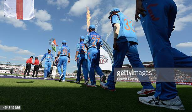 Mahendra Singh Dhoni of India leads out his team ahead of the NatWest International T20 between England and India at Edgbaston on September 7 2014 in...