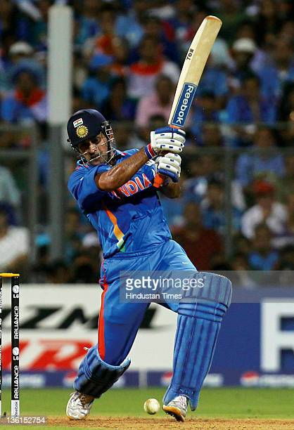 Mahendra Singh Dhoni of India playing a shot during the 2011 ICC World Cup final match between India and Sri Lanka at Wankhede stadium in Mumbai,...