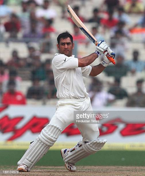 Mahendra Singh Dhoni of India playing a shot during the second day of second Test Match between India and West Indies at Eden Gardens Stadium on...