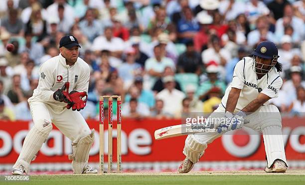 Mahendra Singh Dhoni of India plays a reverse sweep watched by Matt Prior of England during day four of the Third Test match between England and...