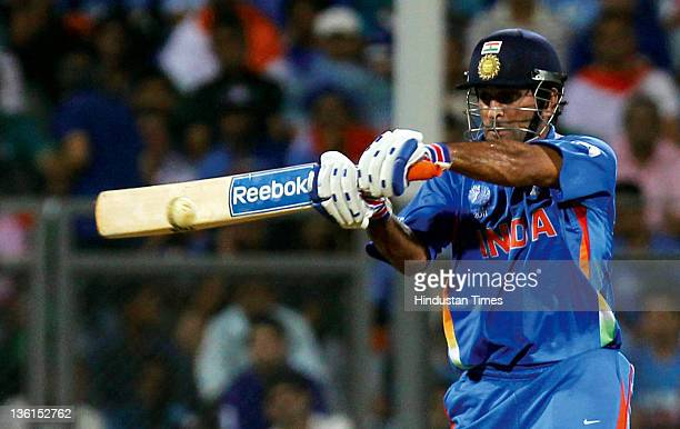 Mahendra Singh Dhoni of India plays a shot during the 2011 ICC World Cup final match between India and Sri Lanka at Wankhede stadium in Mumbai, India...