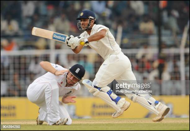 Mahendra Singh Dhoni of India plays a shot past England fielder Ian Bell during the 1st Test match between India and England at MA Chidambaram...