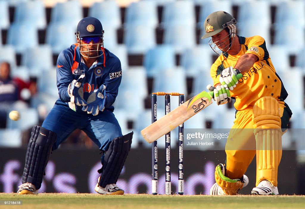 Mahendra Singh Dhoni Of India Watches As Ricky Ponting Hits Out During The ICC Chapions Trophy