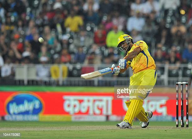 Mahendra Singh Dhoni of the Super Kings hits another six during the 2010 Airtel Champions League Twenty20 final match between Chennai Super Kings and...