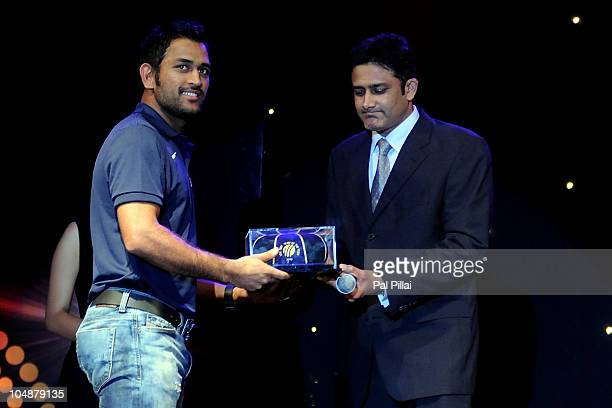 Mahendra Singh Dhoni receives the ICC Test captain of the year award by Anil Kumble during ICC Annual Awards at the Grand Castle on October 6 2010 in...