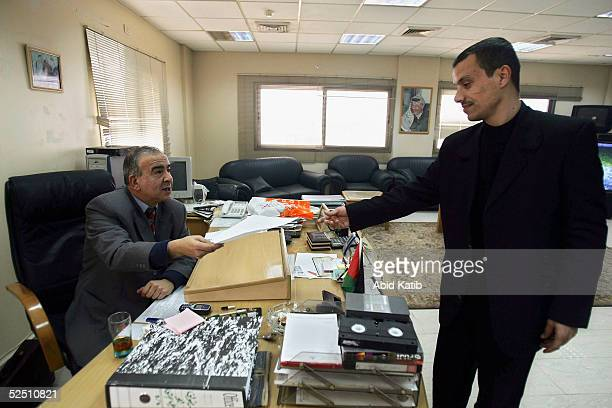 Maher AlRayes the chief of the official Palestinian Satellite Channel works in his office March 22 in Gaza City Gaza Strip AlRayes said that his...